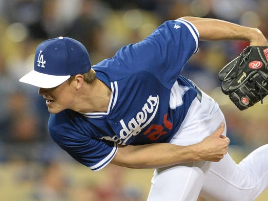 March 27: Los Angeles Dodgers starting pitcher Zack Greinke follows through on a pitch.