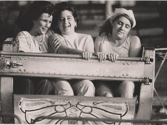 Three women enjoy a ride at Riverview Amusement Park<bold> </bold>in June 1976.