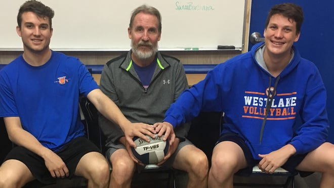 Westlake High volleyball Doug Magorien is flanked by sons Colby, left, and Troy. Magorien will end his remarkable leading the Warriors program at the end of this season.