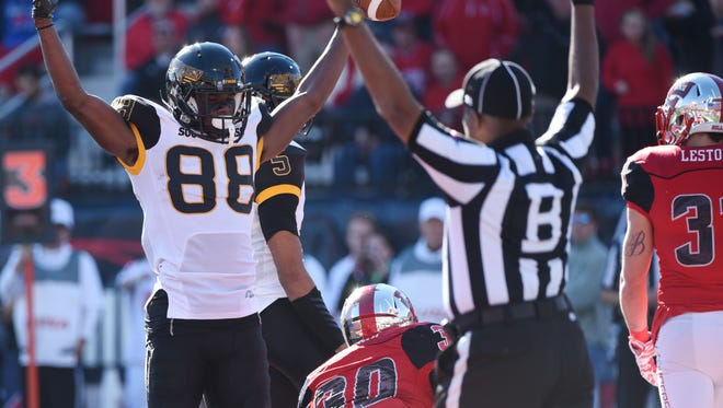 Southern Miss wide receiver Michael Thomas scores a touchdown in the first half as he set the single-season school record for receiving yards.
