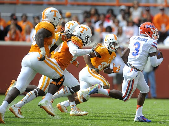 Florida quarterback Treon Harris (3) outruns a host of Vol defenders as the University of Tennessee plays Florida in the second half in Neyland Stadium. Saturday Oct. 4, 2014, in Knoxville, TN.