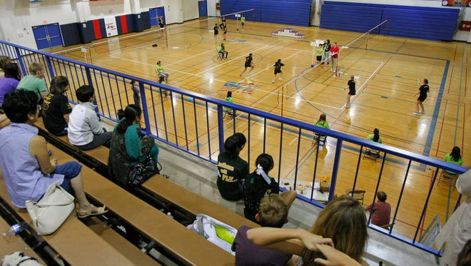 Fans watch the state badminton tournament at Glendale Independence High School