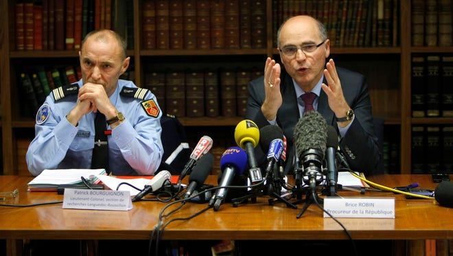 Marseille' State Prosecutor Brice Robin, right, and Lieutenant-Colonel Patrick Bourguignon of the National Gendarmerie, speak with media about the horse meat on Dec. 16, 2013.