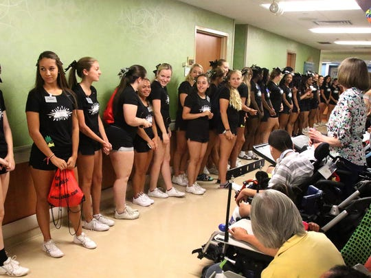 Cheerleaders perform at Children's Specialized Hospital in Mountainside on Monday as the Snapple Bowl's Union County All-Stars made their annual visit.