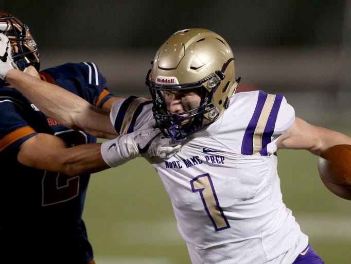 Notre Dame Prep's Jake Smith (1) fights his way out