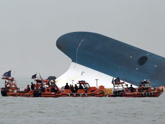 Ferry sinks in South Korea, nearly 300 still missing