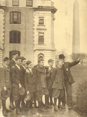 Rufus Stanley, far right with hat, shows Elmira-area