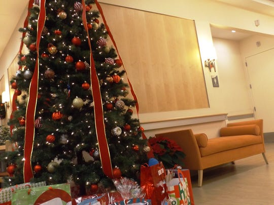 A sample of the presents donated by St. Thomas lined a Roosevelt Christmas tree.