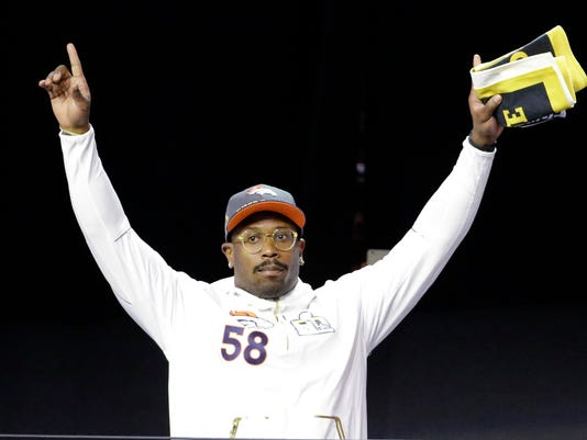 Denver Broncos' Von Miller acknowledges the crowd as he is introduced at Opening Night for the NFL Super Bowl 50 football game Monday, Feb. 1, 2016, in San Jose, Calif. (AP Photo/David J. Phillip)