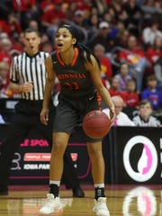 Naomi Jackson, 11, Grinnell, directs the action as she brings the ball down court during Grinnell's 69-48 Class 4A championship loss to Marion. Jakcson scored 11 points for the Tigers and was named to the all-tourney team.