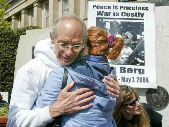 Michael Berg is hugged by a supporter at a gathering in memory of his son, Nick Berg, in West Chester, Pennsylvania, on May 7, 2005.