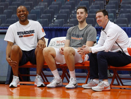 Syracuse assistant coaches Adrian Autry, left, Gerry McNamara, right, and Syracuse's Tyler Lydon, laugh as they watch drills before an NCAA college basketball game against Boston University in Syracuse, N.Y., on Saturday, Dec. 10, 2016. (AP Photo/Nick Lisi)
