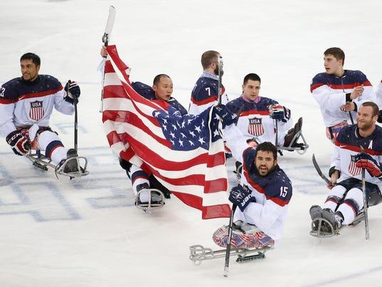 2014-3-15-sochi-paralympics-united-states-sled-hockey