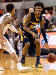 Murray State guard Ja Morant (12) works around Auburn guard Bryce Brown (2) during a game in December.