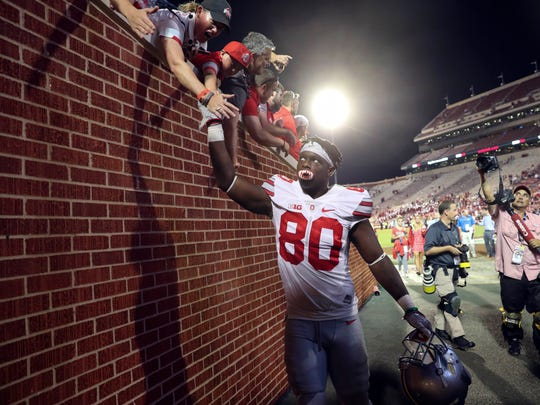 Ohio State receiver Noah Brown celebrates with fans after catching a school record-tying four touchdowns in Saturday's 45-24 win at Oklahoma.