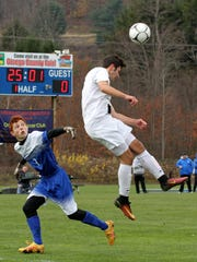 Elmira Notre Dame defender Nate Snavely jumps to head the ball away from Westhill's Brad Zell.