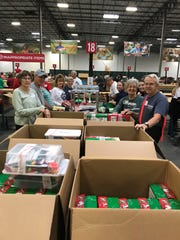 San Angelo area volunteers joined hundreds of others for a weekend at Grapevine processing Operation Christmas Child shoebox gifts. Among those on the left side of the table are Sue Smith, Scott Warren, Tweedy Warren and Linda Borm, all from Grace Fellowship Church in Ballinger; and on the right are Ferd Koehn, Dianna Spence and Bob Smith.