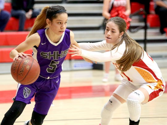 Shadow Hills' Dominique Urbina dribbles the ball as Palm Desert's Shawna Aguerrebere defends her during the game in Palm Desert on Wednesday, January 11, 2017.
