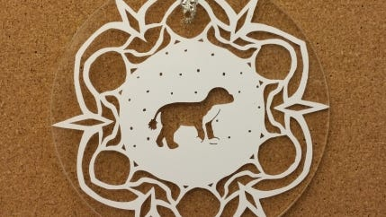 """A """"Bo-flake"""" ornament from 2012, featuring the likeness of Bo, the Obama family dog."""