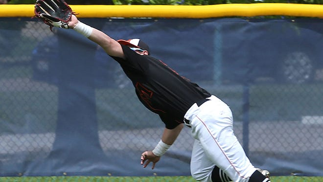 Marlington's Anthony Sabatino makes a diving catch in a tournament game against Norton in May 2019.