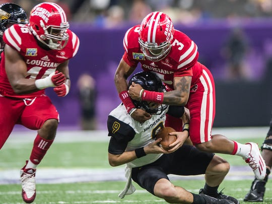 UL linebacker Joe Dillon (3), shown here recording a sack in the New Orleans Bowl, was tabbed as a preseason All-Sun Belt first team selection.