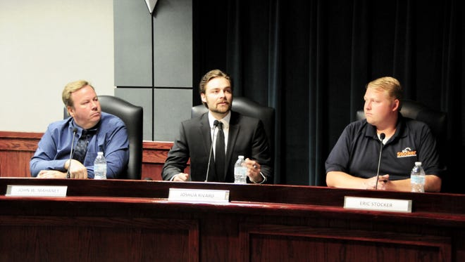 State House candidate Joshua Rivard, center, talks during a debate for 81st District hopefuls on Wednesday, July 11, 2018, in Marysville, while Republican candidates John Mahaney, left, and Eric Stocker, right, watch one. Rivard is the only Democrat in the running. Voters will narrow down the field of eight Republicans down to one Aug. 7.