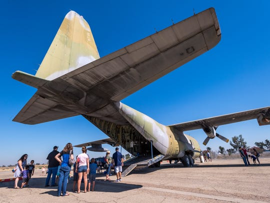 Visitors wait to enter a C-130 cargo plane during Airport