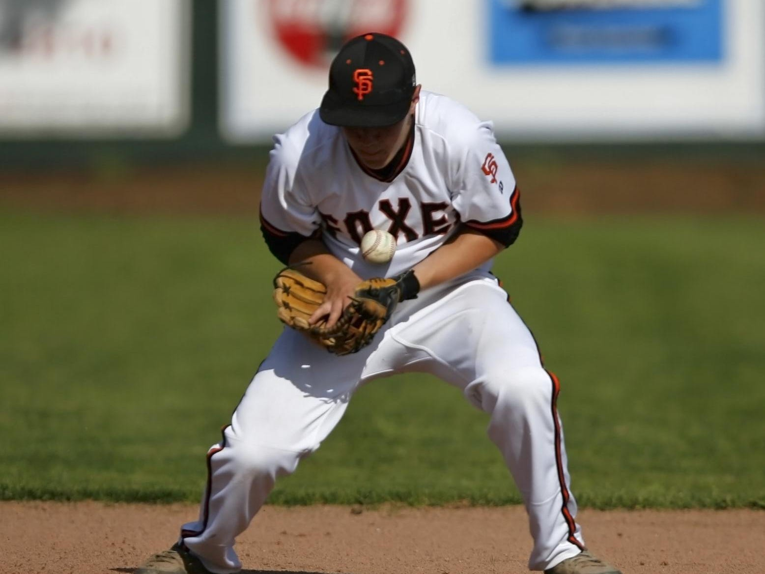 Silverton shortstop Grant Roth stops a ground ball in the top of the third inning of Silverton's 9-2 loss in a Mid-Willamette Conference baseball game, at Silverton, on Wednesday, Apr. 30, 2914.