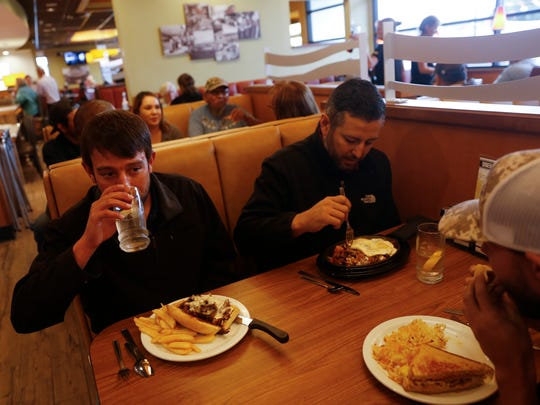 From clockwise left, Nathan Compton,Tom Madrid  and Joe Kelly, enjoy lunch, Wednesday, Sept. 27, 2017 at Denny's in Farmington.