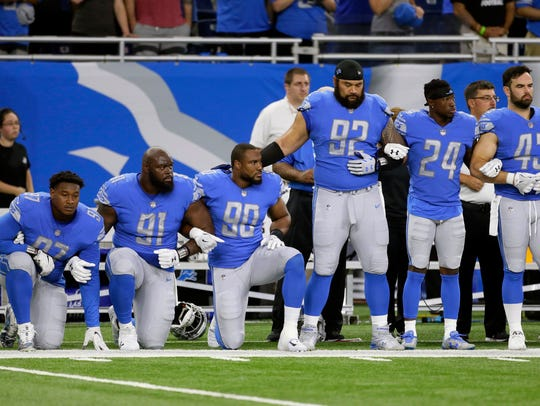 Sept. 24, 2017: Lions players link arms and kneel during