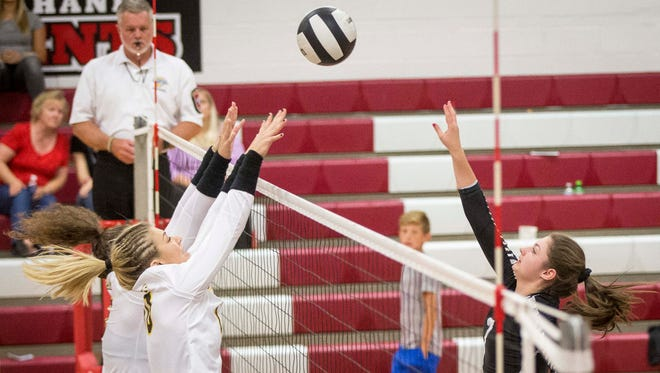 Daleville's Ellie Halbert hits against Cowan during the Delaware County Volleyball Tournament on Sept. 28 at Wapahani High School. Cowan won the game 3-1.