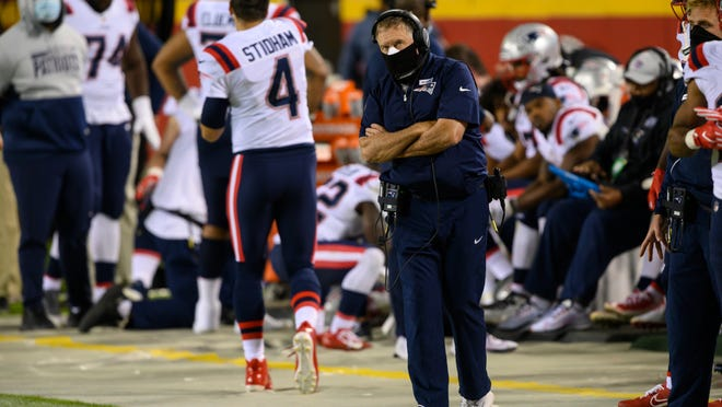 New England Patriots head coach Bill Belichick looks on during the second half of last Monday's game against the Kansas City Chiefs. This Monday's game against the Denver Broncos has been postponed to Sunday, Oct. 18, because of the coronavirus outbreak on the team.