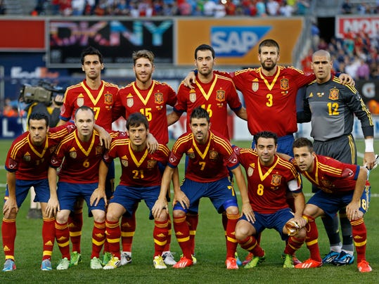 FILE - In this June 11, 2013 file photo, Spain soccer team poses prior to the start  an international friendly soccer match against Ireland at Yankee Stadium in New York. Foreground from left, Pedro, Andres Iniesta, David Silva, Davis Villa, Xavi Hernadez, Jordi Alba. Background from left, Alvaro Arbeloa, Sergio Ramos, Sergio Busquets, Gerard Pique, Victor Valdes. (AP Photo/Kathy Willens, File)