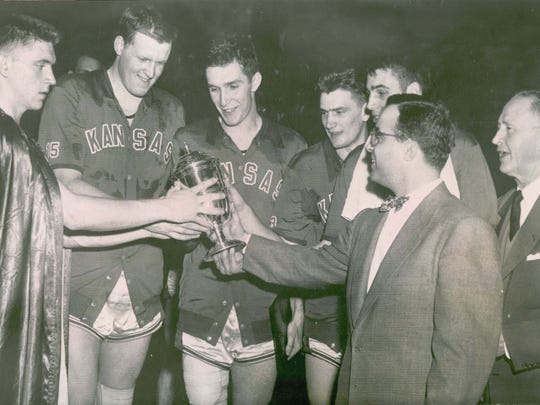 Clyde Lovellette (second from left) won a national title at Kansas, an Olympic gold medal and NBA titles with Boston.