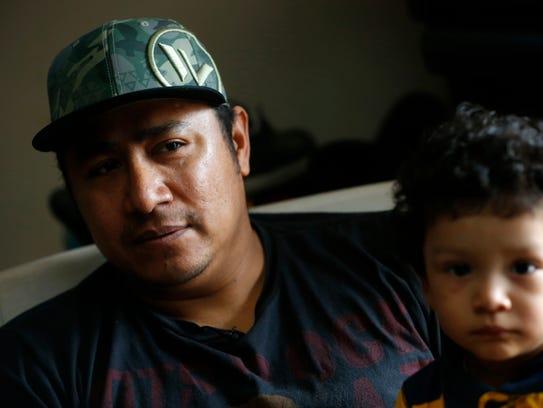 Leonardo Morales, sitting with son Leonardo Morales,