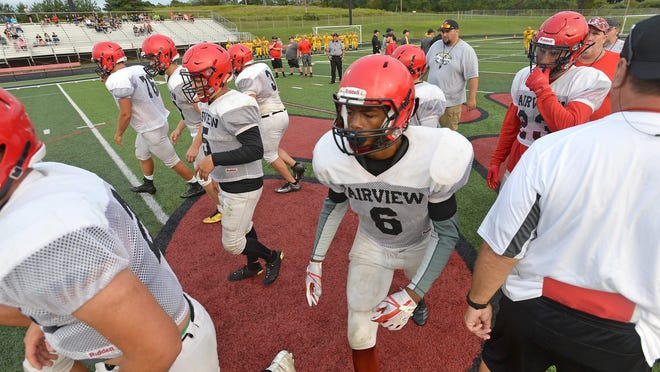 Fairview's football team gets set to run a play in a scrimmage against Northwestern at Keck Field at Jack Bestwick Stadium on Aug. 18, 2018. The 2020 Fairview players are waiting to see if they will have a season. Northwestern, meanwhile, already has been approved to play by its school board.