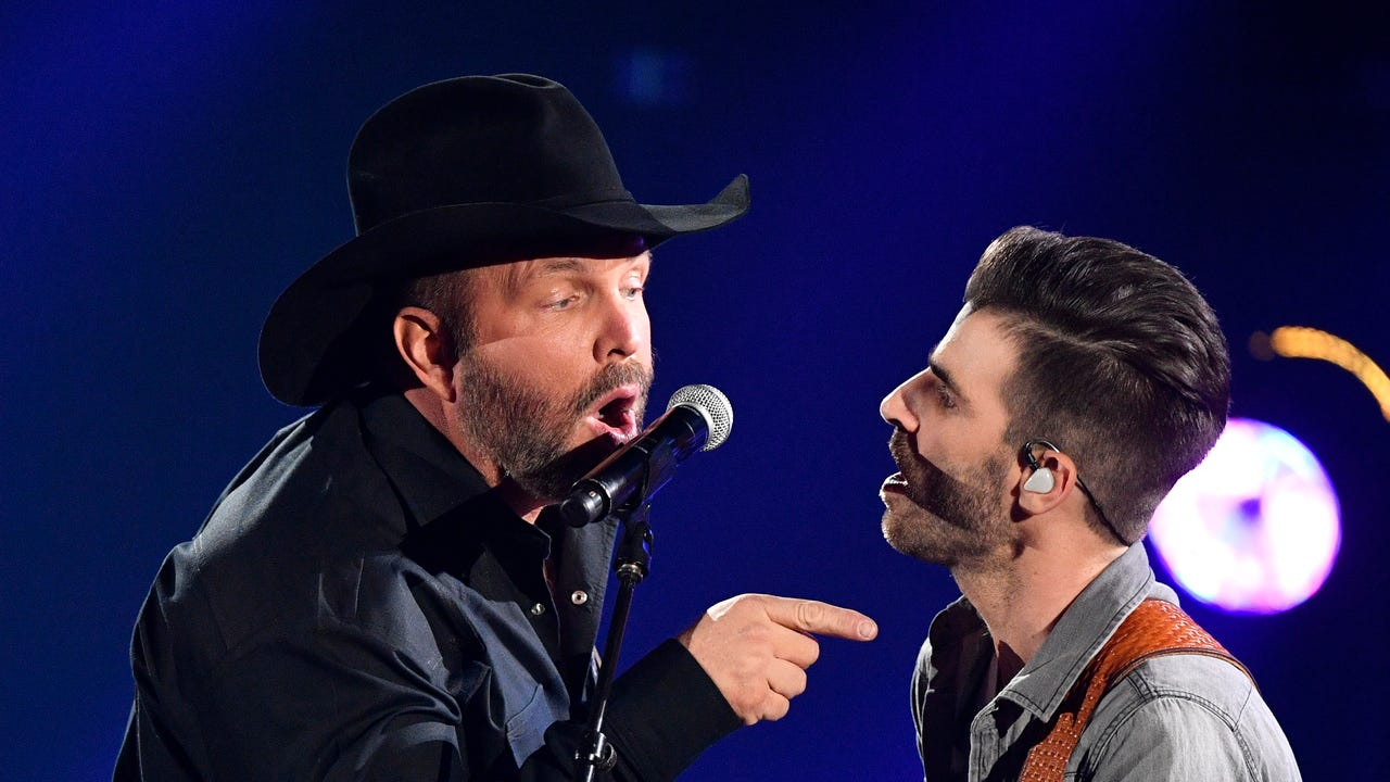 Garth Brooks says he lip-synced at the CMA Awards because he was sick.