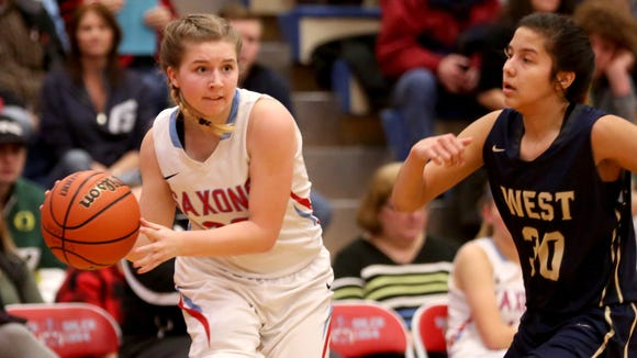 South Salem's Faith Schuetz (20) moves past West Albany's