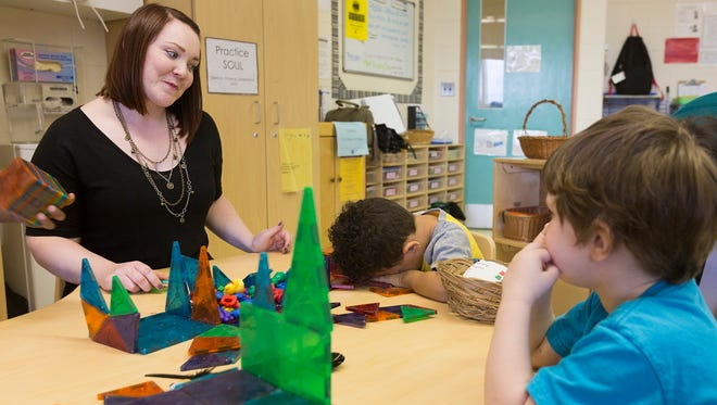 Pre-school Behavioral Health Therapist for the Livonia Birth to Five Starfish Family Services program, Lindsey Fanning, left, talks with pre-schooler Isaac Kilafi, center, and Nathaniel Fannin, during class.