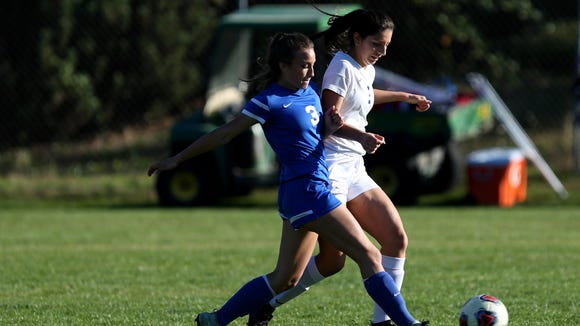 Western Mennonite's Kieley Griffin (3) and Blanchet's Briana Anaya (1) both chase the ball in the Western Mennonite vs. Blanchet girls soccer game at Blanchet Catholic School in Salem on Thursday, Oct. 5, 2017. Western Mennonite won the game 2-0.
