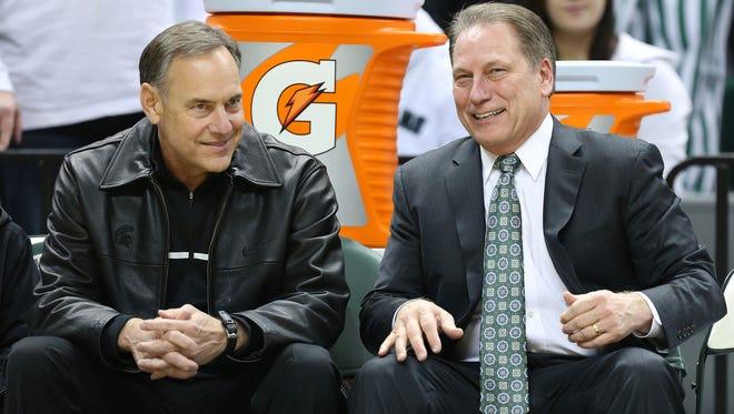 Michigan State football coach Mark Dantonio, left, and basketball coach Tom Izzo talk prior to a game.