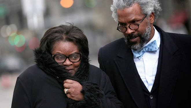 Willye Pearsall, 65, of Warren, and her lawyer Todd Perkins leave Federal court on Thursday, April 7, 2016, in Detroit.