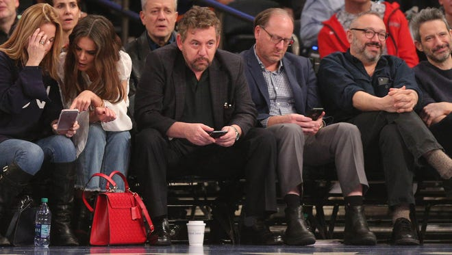 New York Knicks owner James Dolan, center, in attendance Friday night during the first quarter against as the Knicks hosted the Denver Nuggets at Madison Square Garden