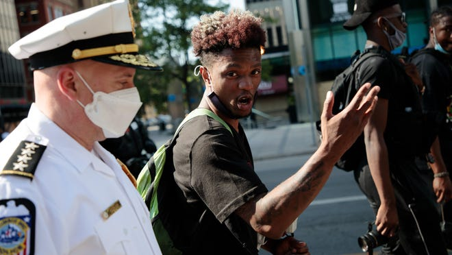 John Lunsford Jr., 22, of Columbus, talks with Columbus Division of Police Chief Thomas Quinlan as police and protesters march together down Broad Street as protests continued on Tuesday, June 2, 2020 following the death of George Floyd in police custody in Minneapolis.