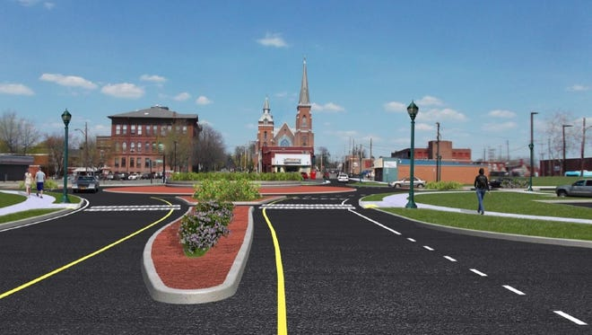 A rendering of the finished roundabout on North Main Street in Elmira by Fisher Associates, the firm designing the project.