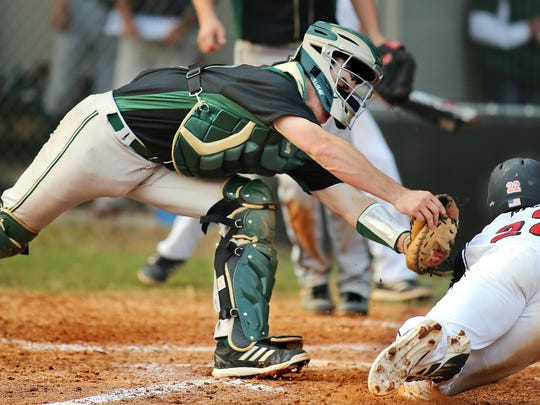NFC's Matthew Railey tried to score from second base on a base hit, but Lincoln  catcher Gage West stretched to make the tag. North Florida Christian held off a late Lincoln rally to win a baseball game, 7-5 on Thursday, February 21, 2013 at Eagle Field.
