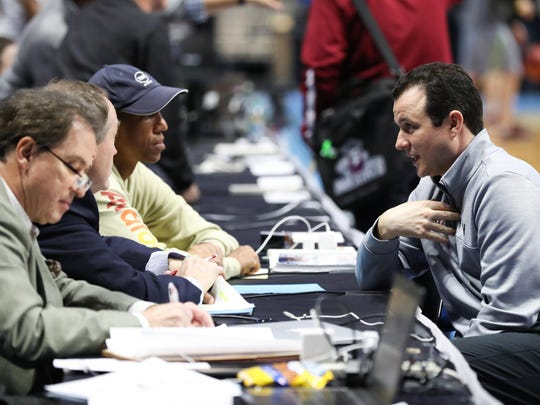 New Mexico State Aggies head coach Paul Weir, right, talks with the truTV commentating team, including Reggie Miller (top left), during practice at the BOK Center in Tulsa, Okla., on Thursday.