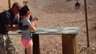 Firing-range instructor Charles Vacca, 39, is seen assisting a 9-year-old girl with an Uzi seconds before the weapon recoiled upwards, shooting Vacca in the head and fatally wounding him.