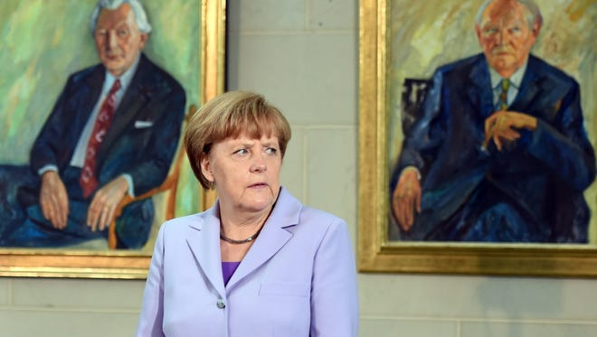 German Chancellor Angela Merkel waits to receive guests at the chancellery in Berlin on July 13, 2015.