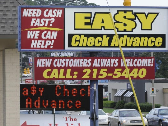 """Payday loan stores seen in Montgomery in 2014. Advocates of reform are pushing a """"30-days-to-pay"""" bill, extending the time needs to pay off short-term loans."""